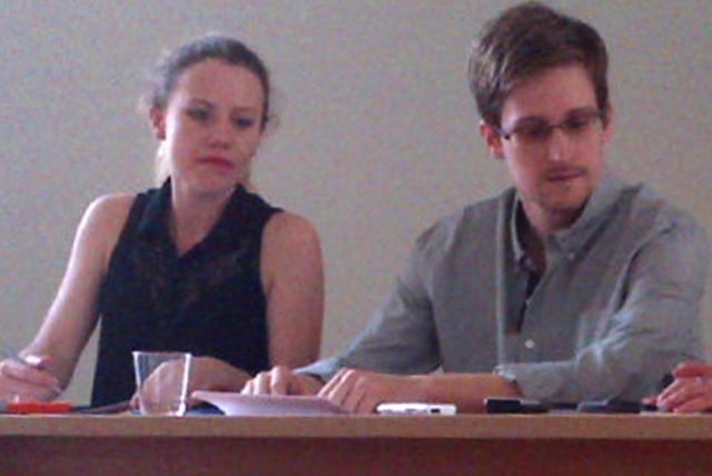 Picture released by Human Rights Watch shows US National Security Agency (NSA) fugitive leaker Edward Snowden (C) during a meeting with rights activists, with among them Sarah Harrison of WikiLeaks (L), at Moscow's Sheremetyevo airport, on July 12, 2013.  Fugitive US intelligence leaker Edward Snowden on Friday told a group of activists that he wanted to claim asylum in Russia because he is unable to fly on anywhere else.